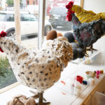 Three chicken footstools adorn the studio window