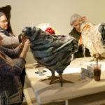 Women work on chicken footstools