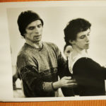 A photo shows Rudolf Nureyev instructing a young Devon Carney.
