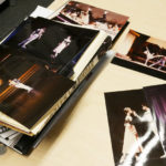 Stacks of photos of Devon performing in Romeo & Juliet are smattered across his desk.