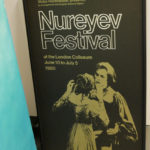 A vintage poster from the Nureyev Festival sits in Devon's office.