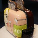 Side view of ceramic toaster and toast made by Shalene Valenzuela