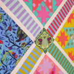 A quilt work-in-progress featuring Tula Pink's All Stars fabric collection.