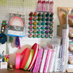 Notions, thread and a pile of books in Tula Pink's studio.
