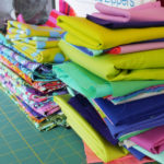 Stacks of fabric wait to be used in Tula Pink's studio.