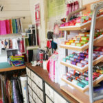 A cabinet full of Aurifil thread in Tula PInk's studio.