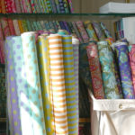 Tula Pink's extra wide quilt backing fabrics in her signature colors.
