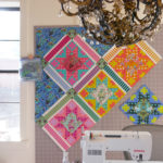 Tula Pink's Bernina sewing machine and quilt design wall.