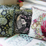 Three of Tula Pink's needlepoint pillows, which were once available as kits.