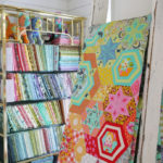 A quilt that features Tula Pink's Tabby Road fabric collection.