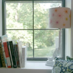 A cozy nook in Tula Pink's studio features inspirational books on William Morris