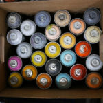 A rainbow of spray paint in Phil Shafer's studio.