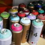 The tools of the trade: a shelf of spray paint in Phil Shafer's studio.