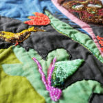 Detail of Nedra's quilt, Spirits of the Forest.