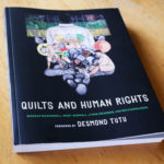 The cover of the book Quilts and Human Rights, which features an article on Nedra.