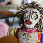 Detail of the beaded face of one of Nedra's handmade dolls.