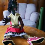 One of Nedra's dolls, featuring a sparkley skirt and embroidered shoes.