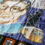 Detail of Nedra's Rosa Parks quilt, shows parks, the Statue of Liberty and a bus.