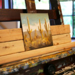 An in-progress desert scene in artist Seth Smith's studio.