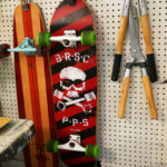 Skateboards hang next to tools in Seth Smith's studio.