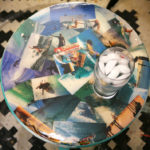 A table decorated with vintage surfing images.