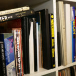 A variety of books in Seth Smith's studio library.