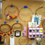 Undecorated wreaths hang in Grace D. Chin's studio.