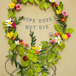 Hope Does Not Die, a paper floral wreath by Grace D. Chin.