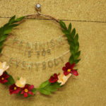 "A floral wreath proclaims ""feminism is for everybody"", made by Grace D. Chin."