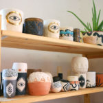 Shelves of Sweet Destructor ceramics.