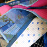 Glimpses of patchwork and stitching on one of Luke's quilts.