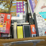 A boxful of stationary waits to be unpacked in Luke's studio.