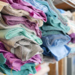 Piles of fabric from Luke's fabric line Dapper for Moda Fabrics.