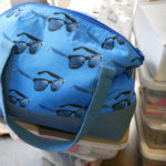 A tote bag features Luke's fabric line which he designed for Moda Fabrics.