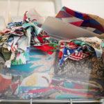 Tubs of fabric surround you in Luke's studio.