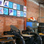 A gallery of Lego letterpress prints hang on the wall of the Two Tone Press studio.