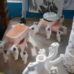 Astronaut planters await the next step in their finishing process.