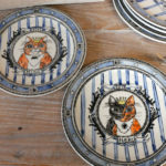 Celebration plates featuring Momoko's cats Hina and Neko.
