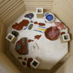 Ceramic pieces from Momoko's community class are fired in her kiln room.